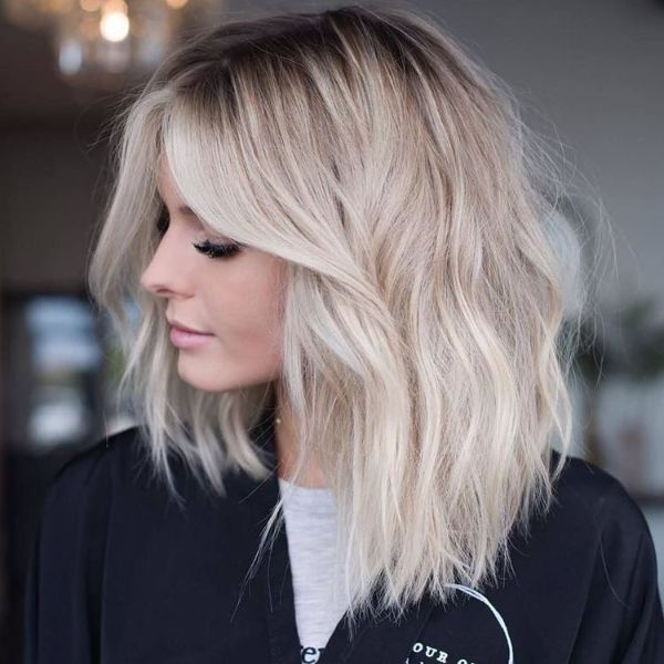 Bleach Blonde Wavy Long Bob with Framing Bangs Hairstyle
