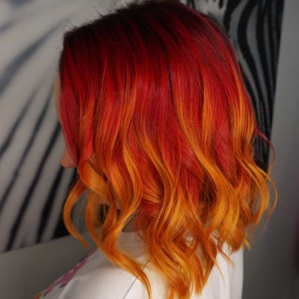 Flame-like colored Lob Cut with Soft Waves Hairstyle
