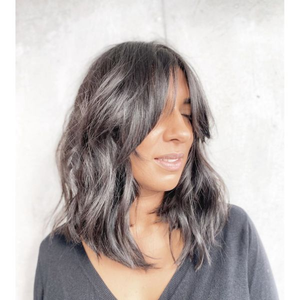 Lived In Dark Brunette Wavy Long Bob Haircut with Bangs