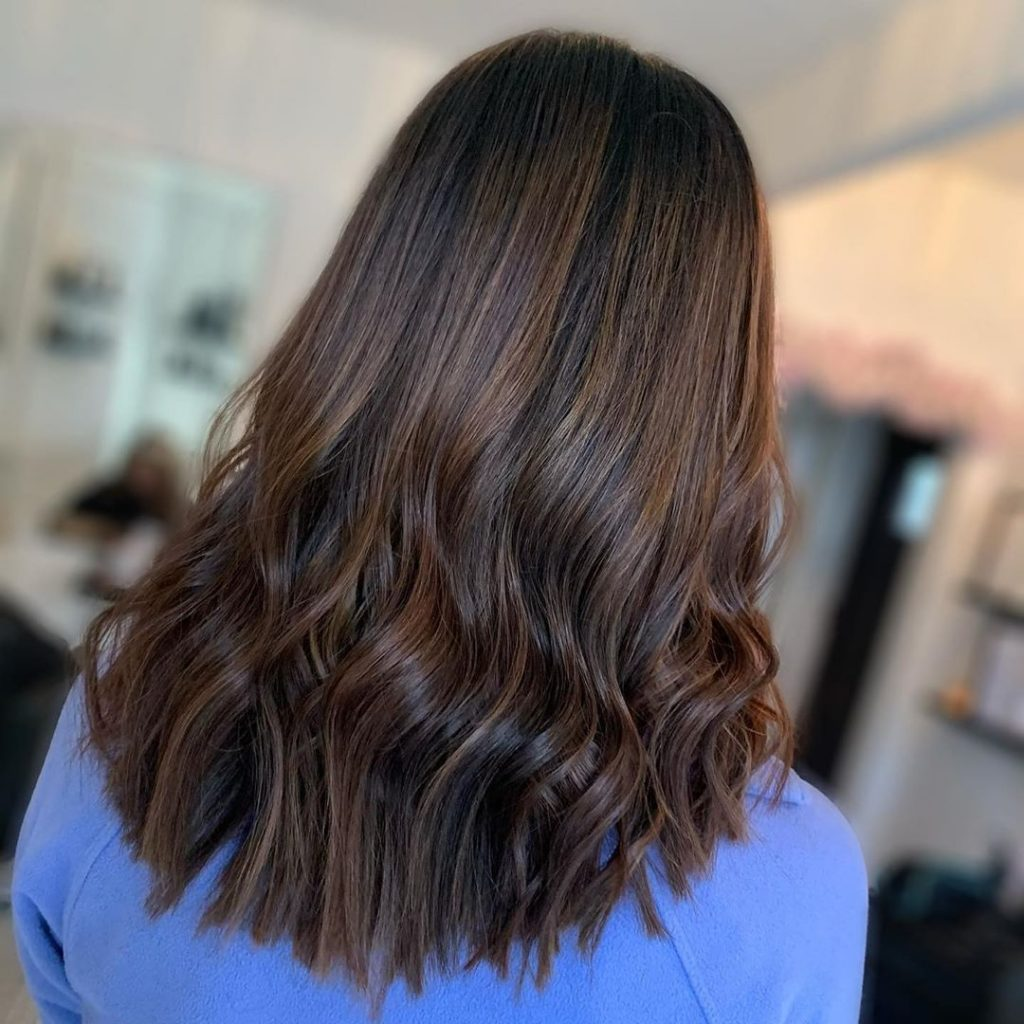 Long Brown hair with soft curls and subtle balayage