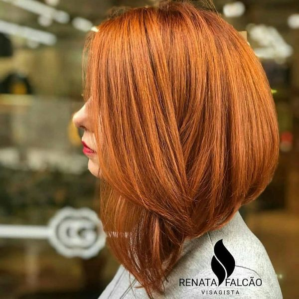 Long Ginger Bob Haircut with Feathered Bangs