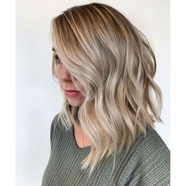 Long Wavy Bob Haircut with Side Swept Bangs and Side Part
