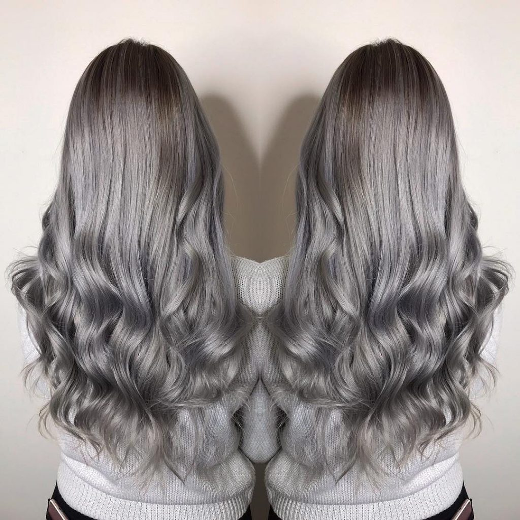 Long ashy balayage hair with soft curls