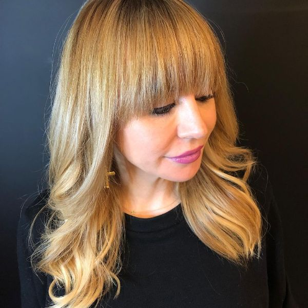 Soft Curls for Long Layered Blonde Hair with Blunt Bangs