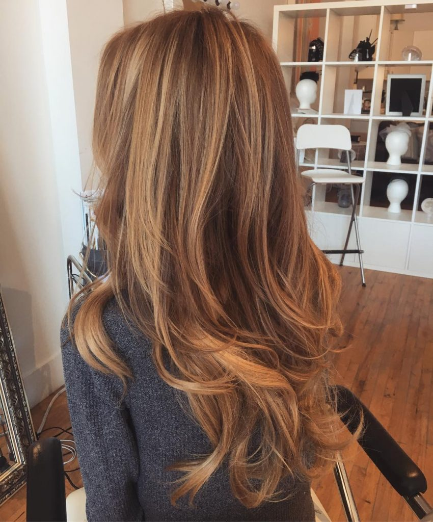 Sun-kissed Caramel Highlights for Long Layered Hair