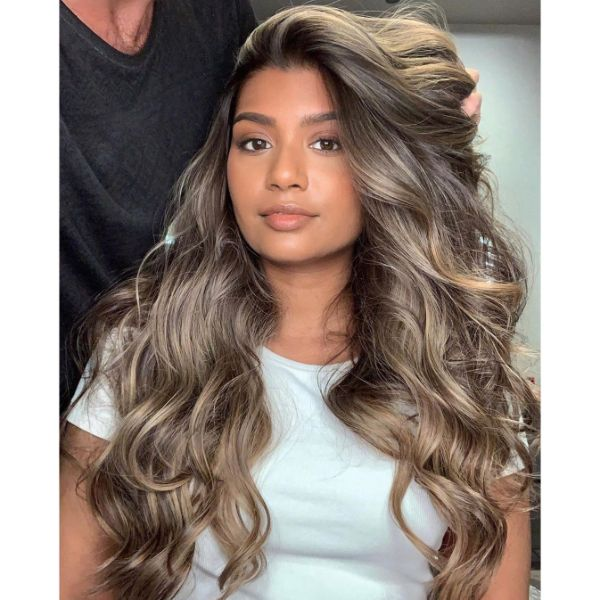 Voluminous Layers for Wavy Hair with Side Part