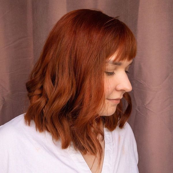 Voluminous Wavy Ginger Long Bob with Straight Bangs