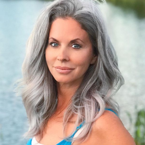 Ashy Blonde Layered Long Hairstyle for Older Women