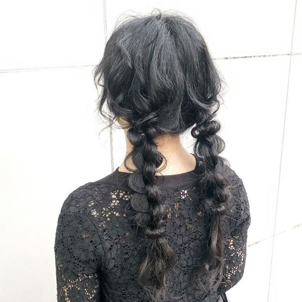 Braided Pigtails with Pulled-out Strands of Hair