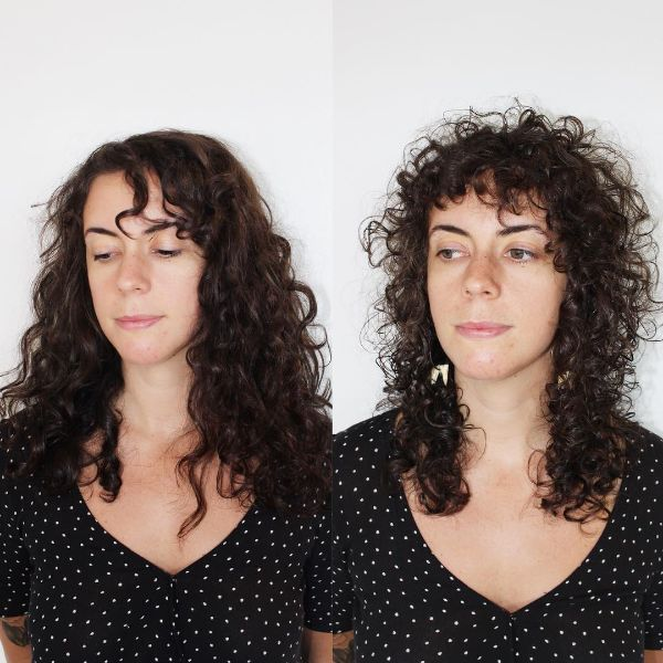 Curly Heavy Layered Hairstyle with Curly Bangs