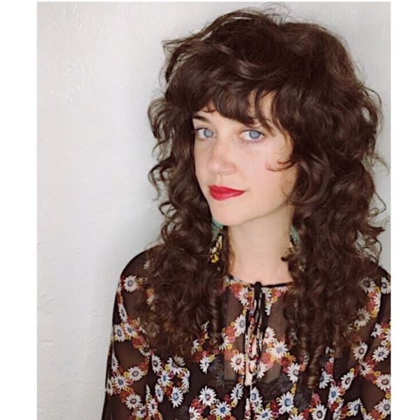 Curly Long Layered Hairstyle with Chunky Bangs