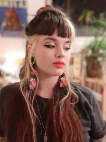 Half Bun for Long Layered Highligted Hairstyle with Straight Cut Bangs