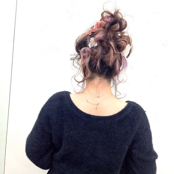 Heavy accessorized High Messy Bun
