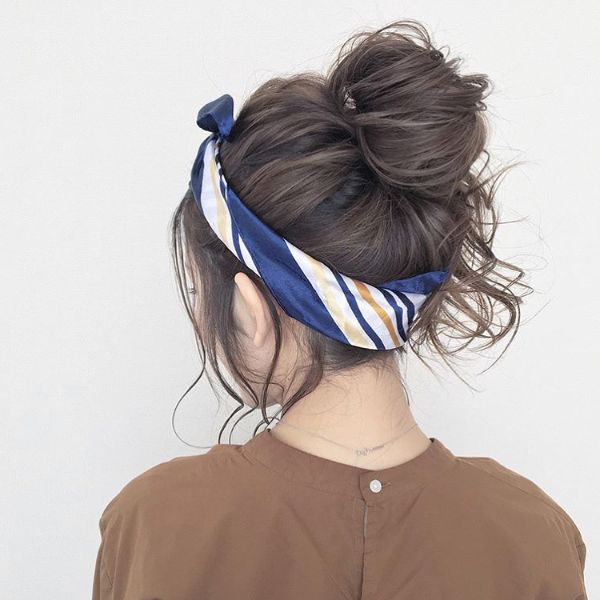 High Messy Bun with Headband Hairstyle