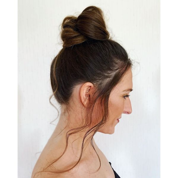 High Messy Bun with Falling Front Pieces for Long Brunette Hair