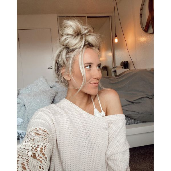 High Messy Flat Big Bun with Falling Front Pieces for Long Blonde Hair