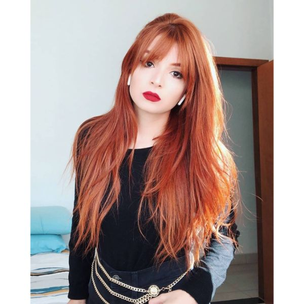 Long V-shaped Layers for Red Hair with Straight Bangs