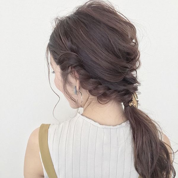 Messy Braided and Twisted Updo with Crown Braids and Ponytail