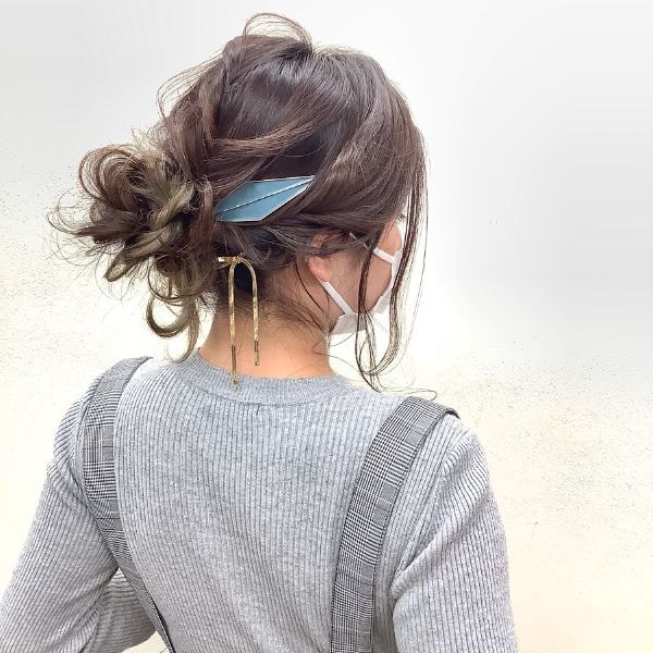 Messy Bun with Massive Hair Accessory