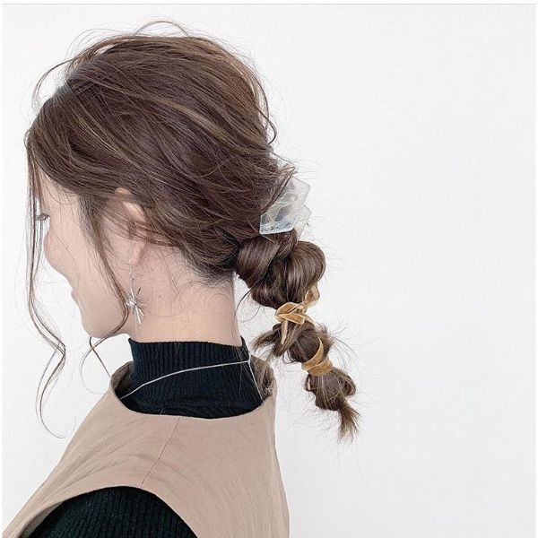 Messy Knotted Low Ponytail with Falling Front Pieces for Long Hair
