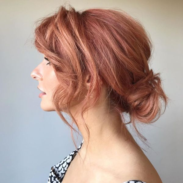 Messy Low Bun for Strawberry Pink Hair with Bangs