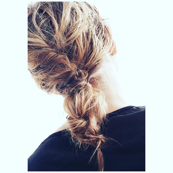 Messy Updo for Long Hair with Twisted Ponytail and Knots