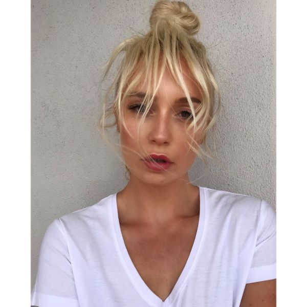 Messy Updo with High Bun and Faux Fringe for Long Blonde Hair