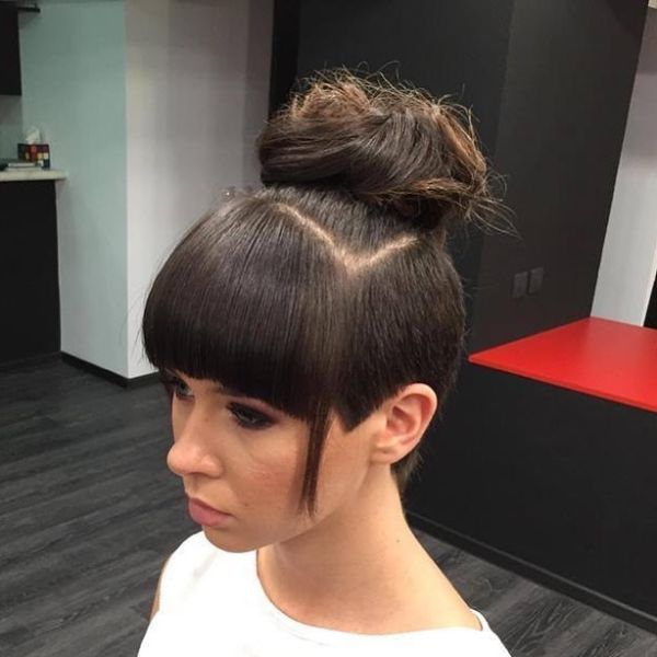 Messy Updo with High Bun and Shaved Sides