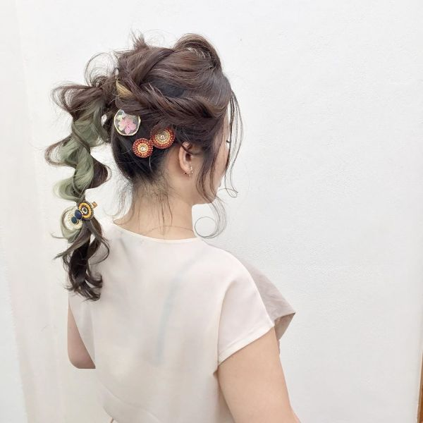 Messy Updo with High Twisted Ponytail and Accesorries for Long Hair