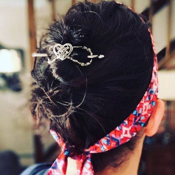 Pin-up Inspired Messy Updo with Hair Clip and Headband
