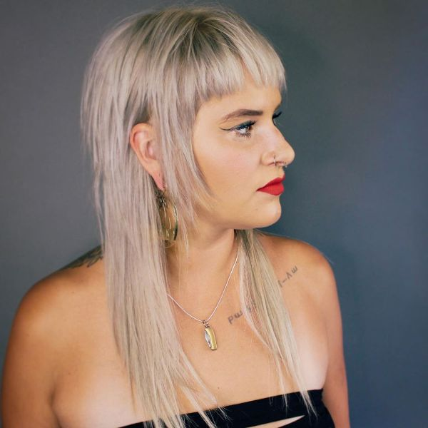 Platinum Blonde Long Shag Cut with Straight Bangs and Long Sideburns