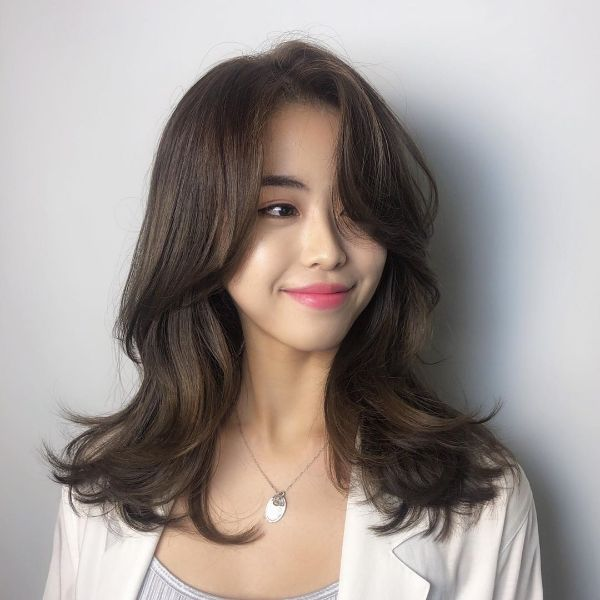 Playful Long Layered Hairstyle with Long Bangs
