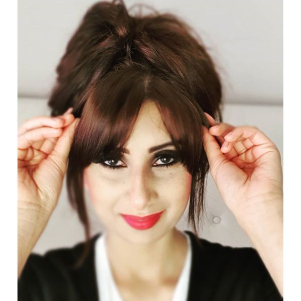 Relaxed Messy Updo with Loose Bun and Bangs for Long Hair