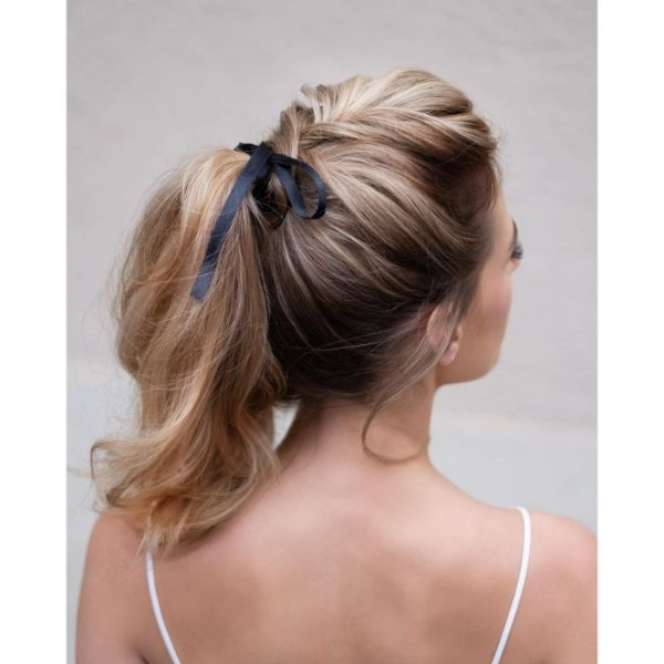 Romantic Messy Updo with Ponytail and Satin Ribbon for Long Hair