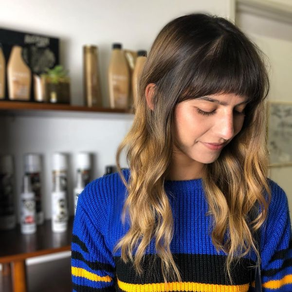 Root Melt Balayage for Wavy Layered Hair with Curved Bangs