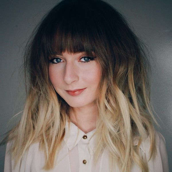 Shaggy Layered Hairstyle with Heavy Bangs for Ombre Hair