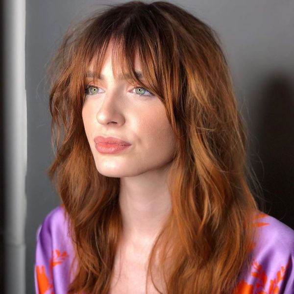 Shaggy Red Layered Hairstyle with Face-framing Bangs