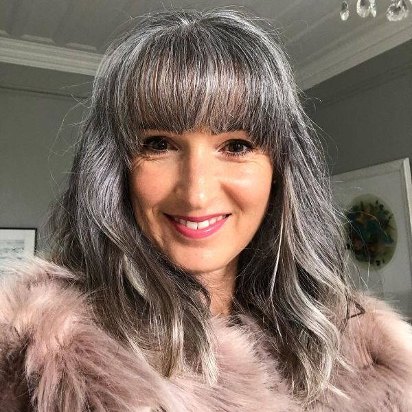 Silver Fox Long Hairstyle with Straight Bangs for Older Women
