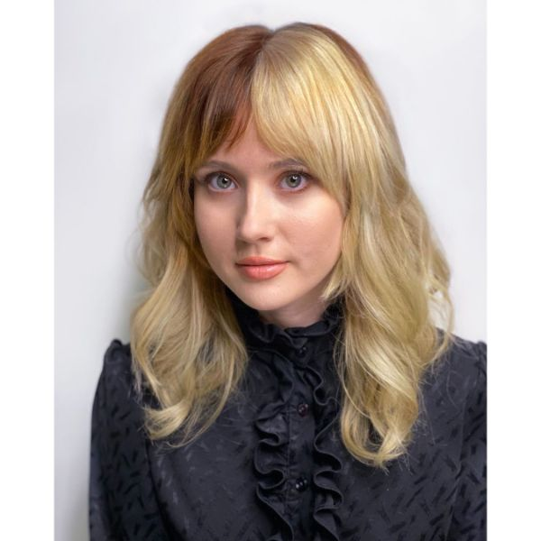 Two-toned Blonde Layered Hairstyle with Wavy Bangs
