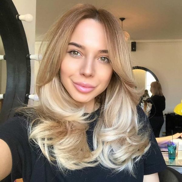 U-shaped Blonde Layers with Face-framing Bangs