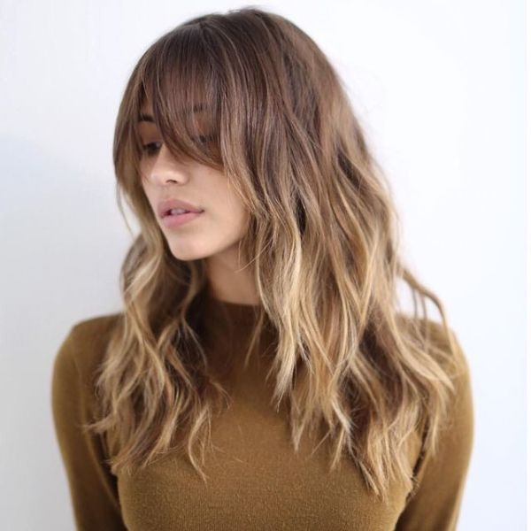Wavy Caramel Balayage Layered Hairstyle with Face Framing Bangs