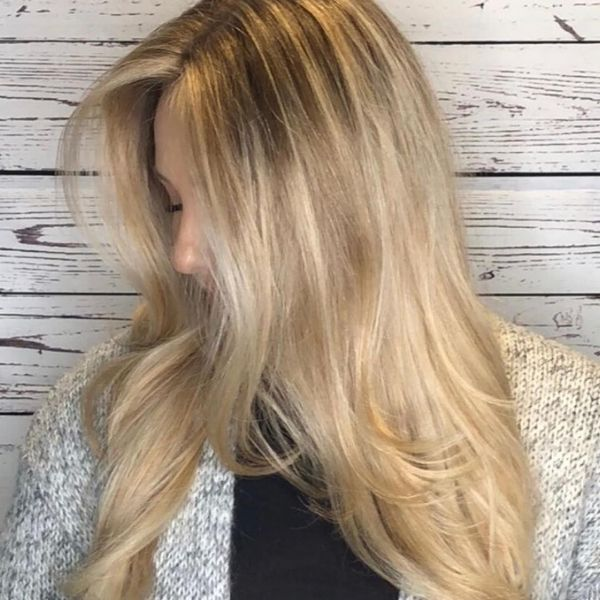 Feathered Layers Blonde Haircut