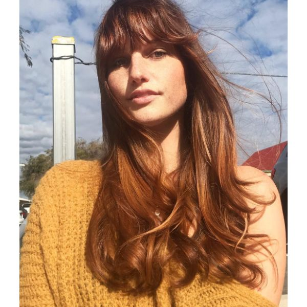 Warm Balayage for Soft Layered Long Cut with Straight Bangs