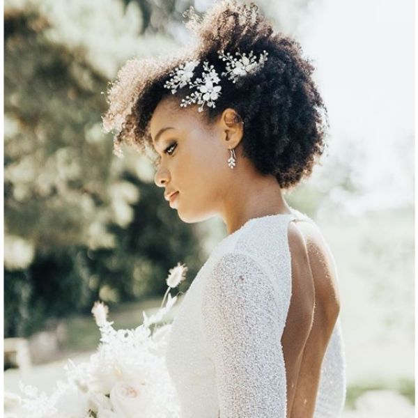 Afro Hairstyle with Flower Accessory bridal hairstyles
