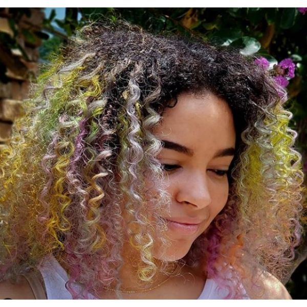 Afro Mid Length Hairstyle with Pastel Highlights