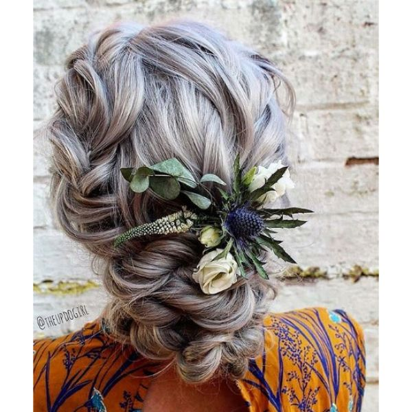 Ashy Twisted Bun Hairstyle with Flower Arrangement