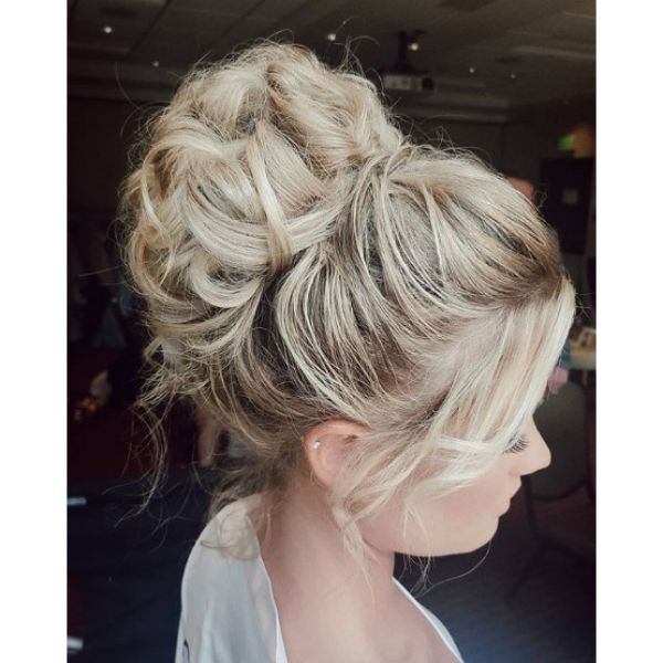Braided Crown Bun with Falling Strands Bridal Hairstyles