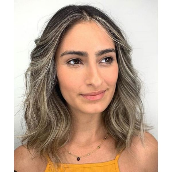 Bright Ashy Blonde Hairstyle with Messy Texture Hairstyle