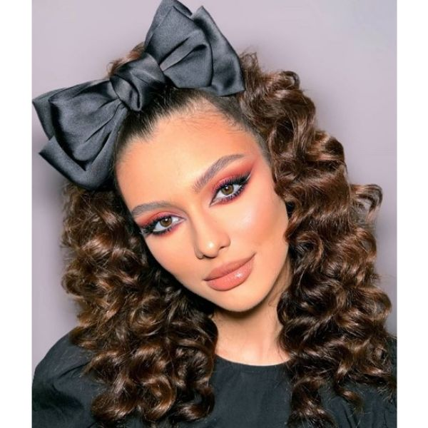 Curly Hairstyle with Black Satin Ribbon