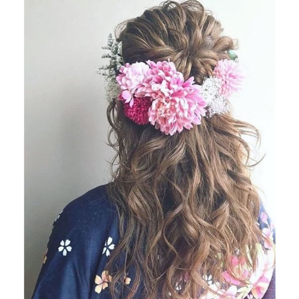 Curly Messy Half Up Half Down Hairstyle with Flower Accessory Bridal Hairstyles